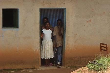 Children looking out doorway