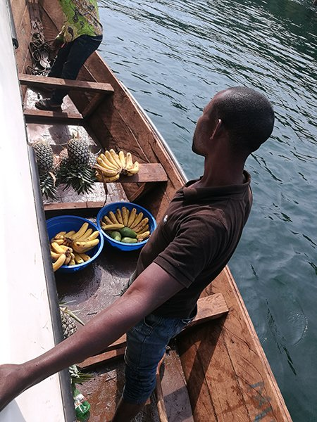 Fruit vendor in boat