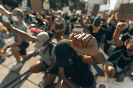 Protesters kneeling with fists raised