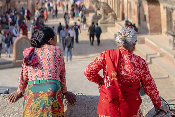 Nepalese women watching street