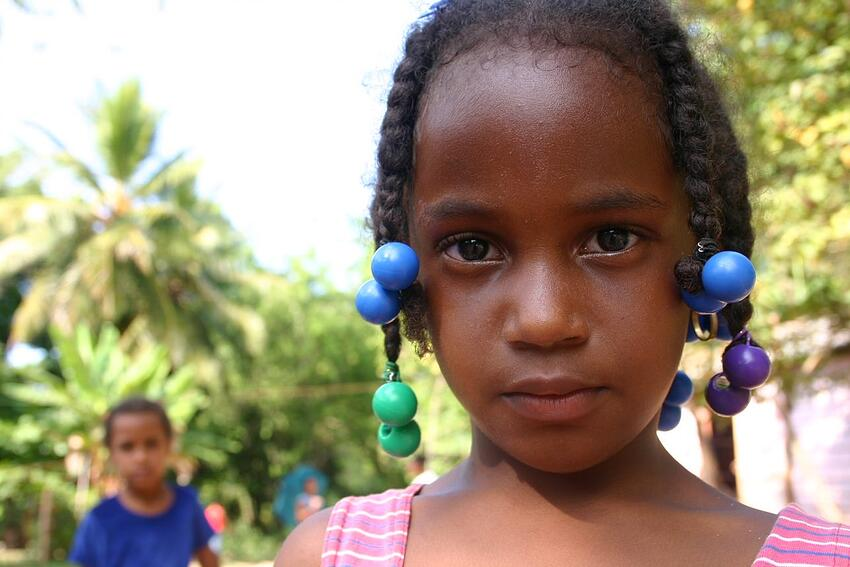 Girl and Boy in Dominican Republic Looking into Camera