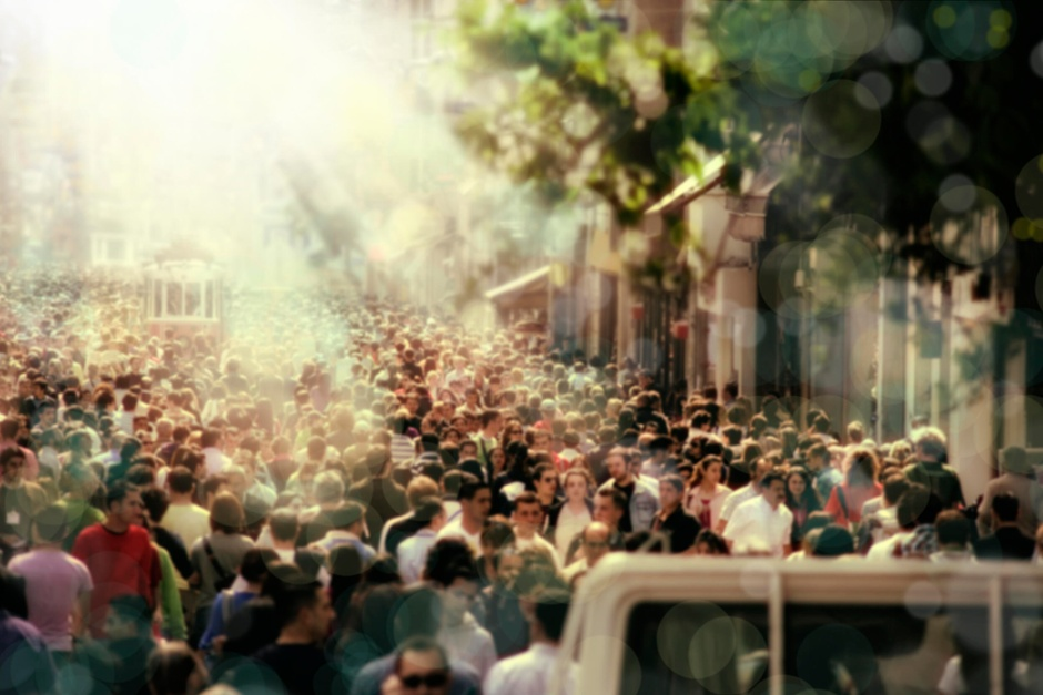 Crowded street basked in sunlight