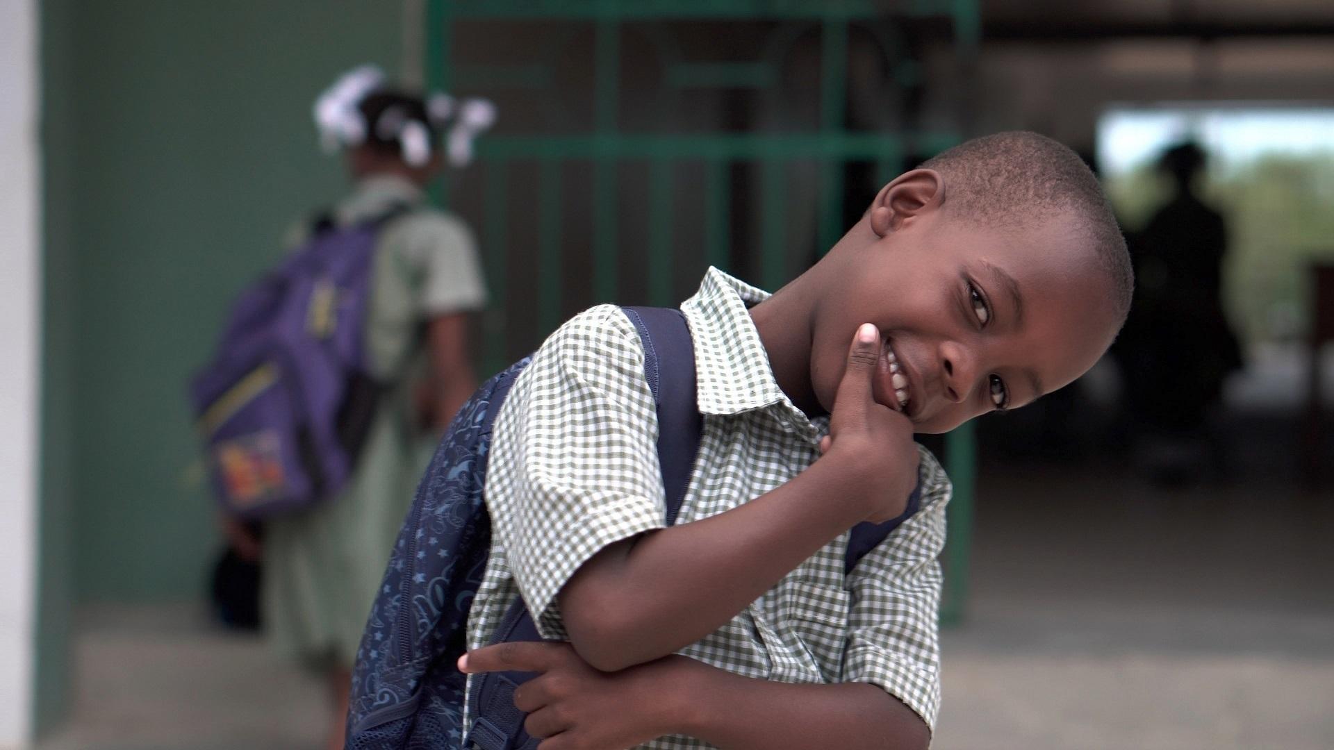 African American grade-school pupil smiling