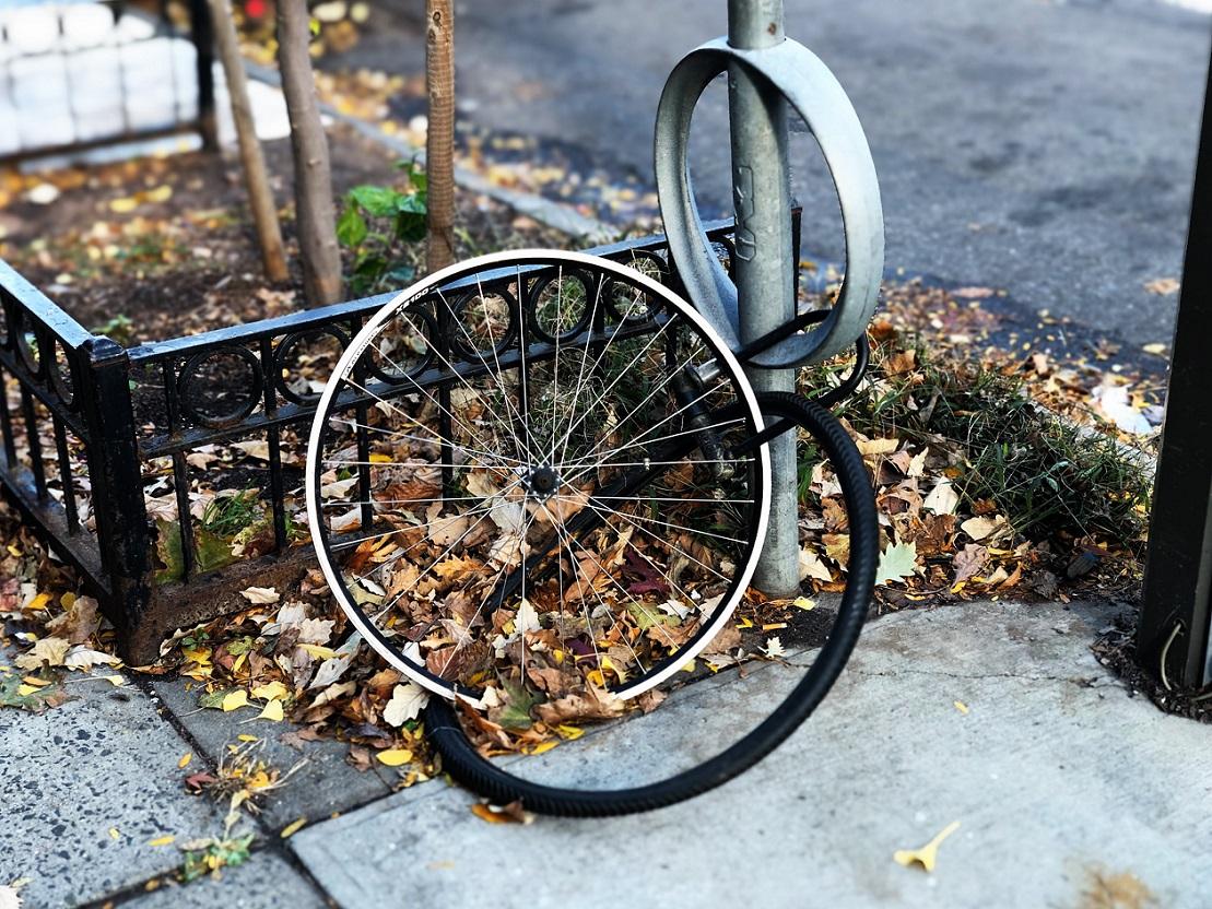 Bike wheel and tire. Photo by Lance Grandahl on Unsplash.