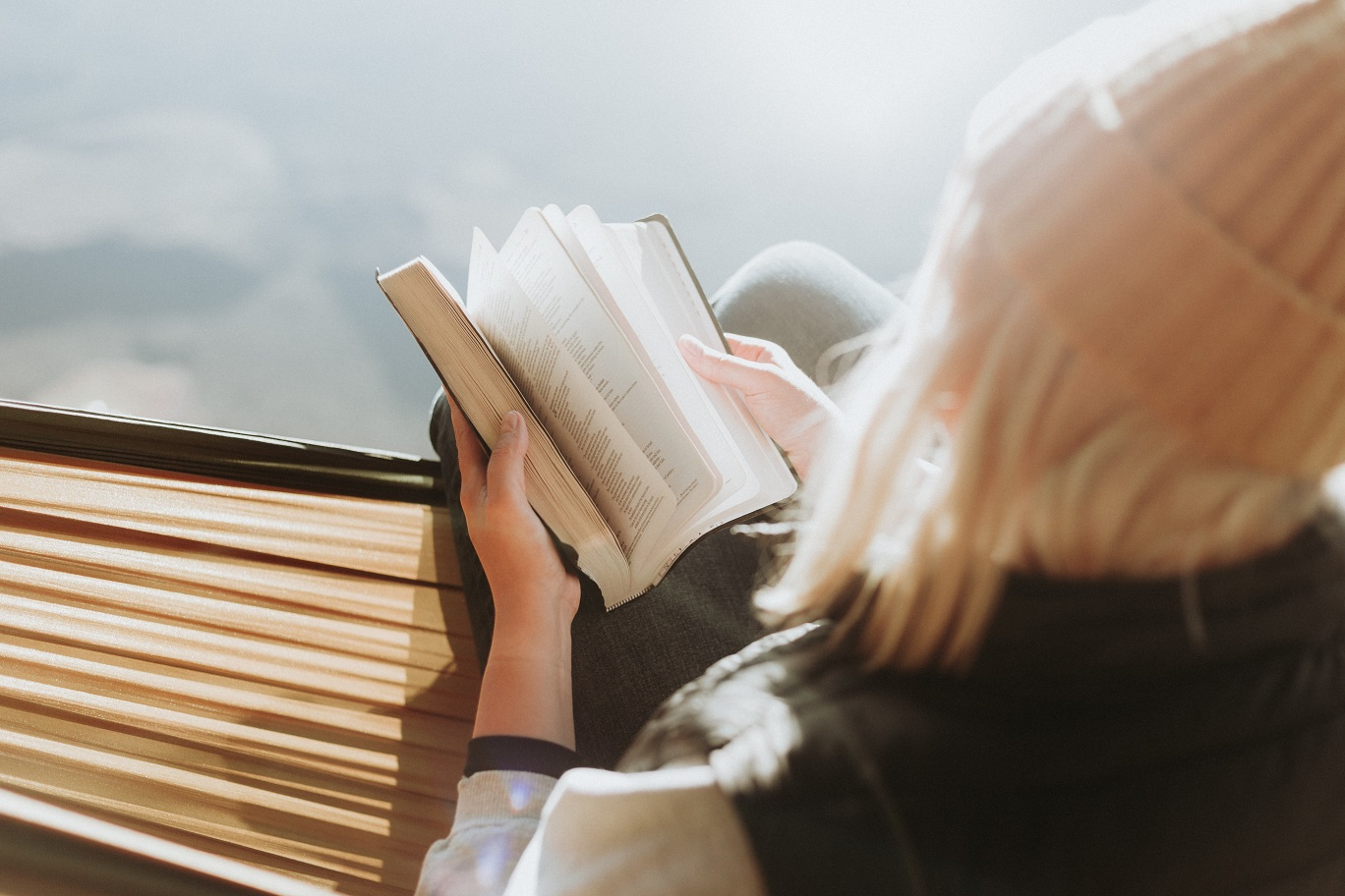 Woman reading book. Photo by Priscilla Du Preez on Unsplash.